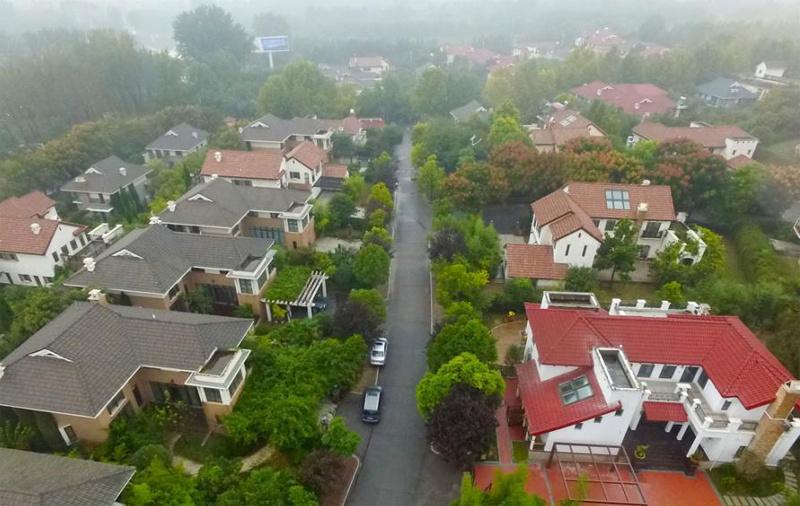 黄河千亩郑州风景区变身别墅群边罚边建达十图纸设计院别墅图片
