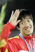 刘翔表情――调皮刘翔惹人迷。Osports/图